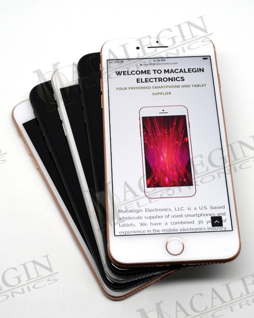 Stack of iPhone 8 used phones with Macalegin watermark.
